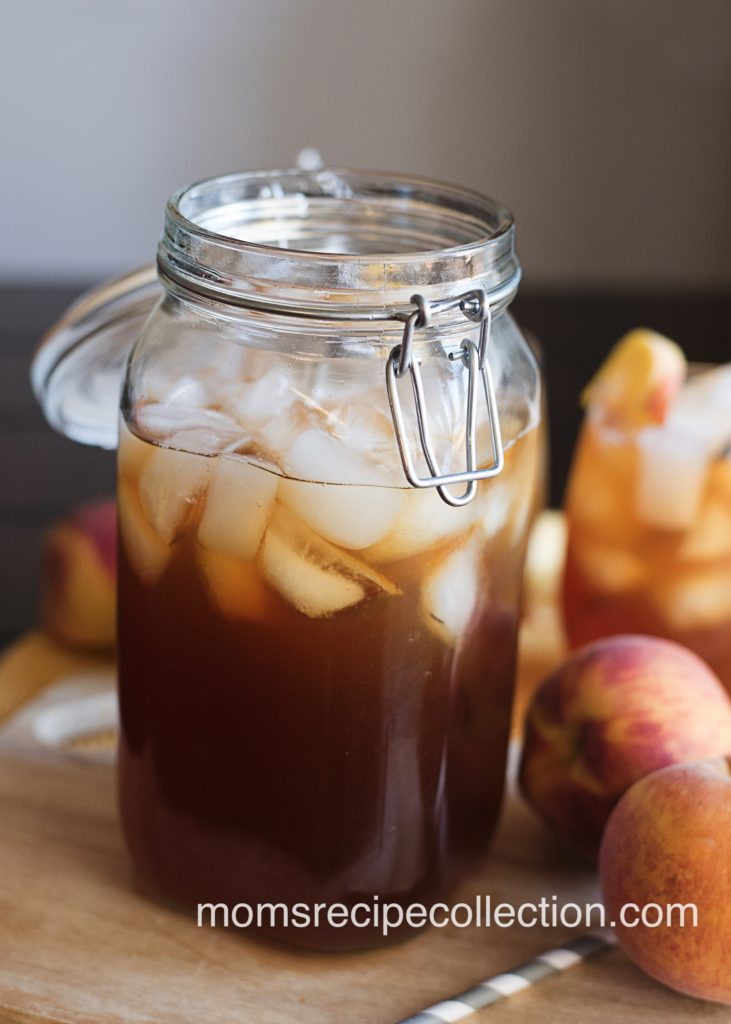 Homemade southern style sweet peach tea is best served in a mason jar on a hot summer day
