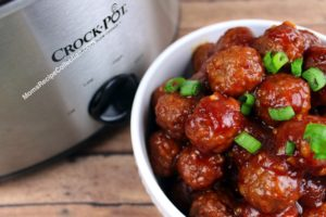 slow cooker meatballs made in the crockpot with cranberry sauce, and orange marmalade.