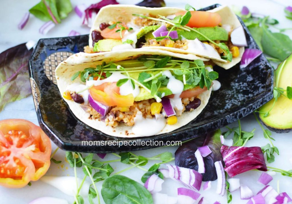 These easy vegan cauliflower tacos topped with fresh veggies and herbs are delicious.