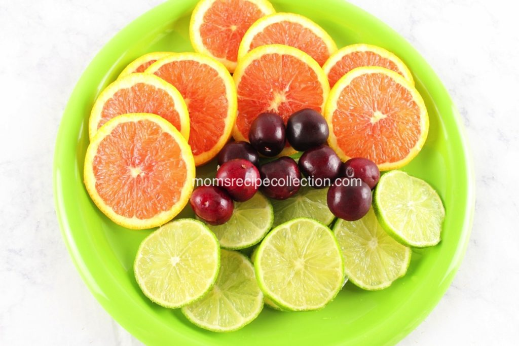Slice oranges, limes and cherries for your fruity sangria.