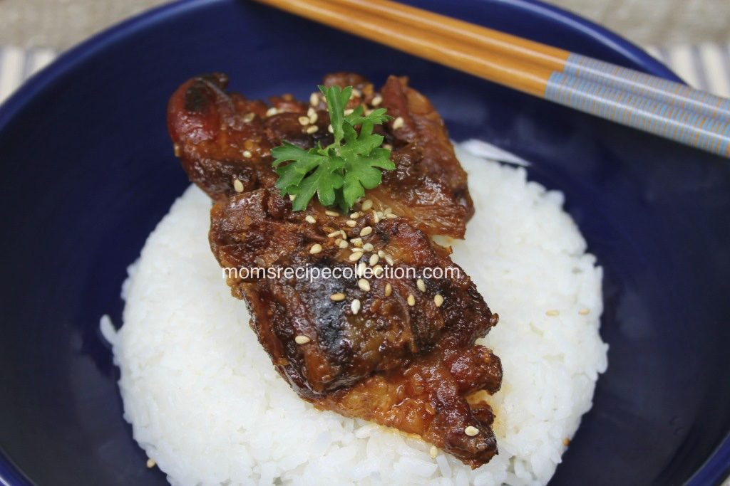 This spicy garlic honey chicken served over rice tastes great with fresh herbs.