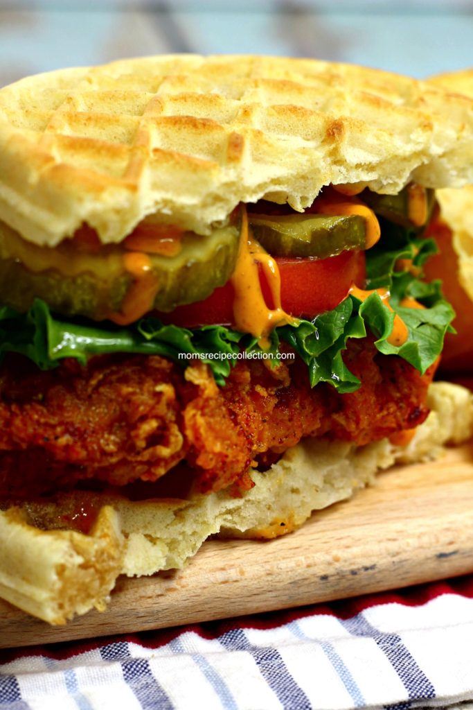 Delicious and juicy fried chicken sandwiched between two waffles, topped with a delicious sauce