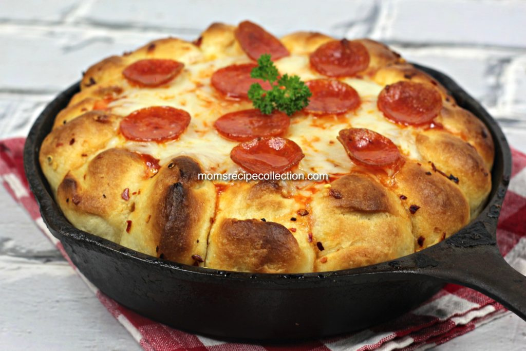 pepperoni pizza dip with melted mozzarella cheese and rolls