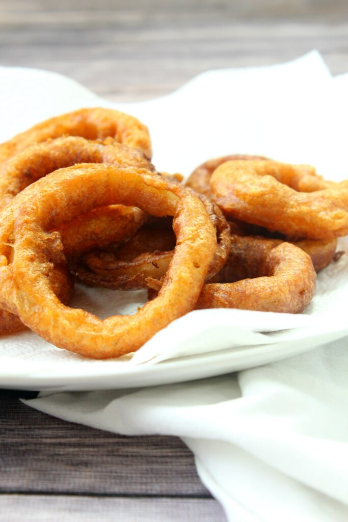 These golden and crispy onion rings will go perfect with burgers.