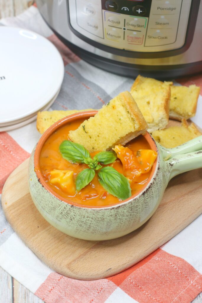 Packed with garlic, basil, and fire roasted tomatoes, this soup hits the spot.